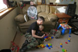 "DM0269   Master Sgt. Jeff ""J.T."" Theiral plays blocks with his two-year-old son Jarret..."