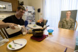 "DM0270   Master Sgt. Jeff ""J.T."" Theiral makes dinner for his two-year-old son Jarret as..."