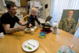"DM0272   Master Sgt. Jeff ""J.T."" Theiral makes dinner for his two-year-old son Jarret as..."