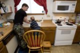 "DM0273   Master Sgt. Jeff ""J.T."" Theiral and his two-year-old son Jarret wash their..."