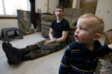 "DM0274   Master Sgt. Jeff ""J.T."" Theiral and his two-year-old son Jarret watch Elmo..."