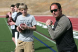 Nate Sassman instructs quarterbacks after school at Classical Academy in Colorado Springs Tuesday...