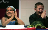 Skyline Vista Elementary School students, L-R Sabrina Herrera, and Ronnie Yanker cheer as Gov....