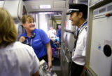 (DENVER, Colo., SHOT 10/05/04) Frontier Airline pilot Kent jokes around with a member of the...