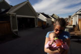 MJM274  Chris Hegstrom (cq) holds her daughter, Grace Hegstrom, 1, as mothers and children gather...