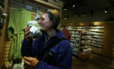 Anne Mudgett, (cq) of Boulder sniffs some of the natural and organic products on the shelves at...