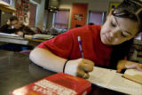 DM2437   Alyssa Rodriguez works on a short descriptive paragraph in Amy Campbell's eighth grade...