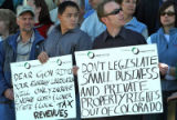 L to R: Nick Granruth (cq) and Jesse White (cq) brought signs to support the Colorado Oil and Gas...