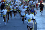 Runners head west on Manitou Avenue in Manitou Springs at the start of fhe Pikes Peak Marathon on...