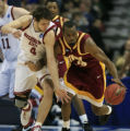 DM0161   Washington State's Nikola Koprivica,left, battles for the ball with Winthrop's Taj...