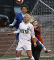 In Class 5A non league girls soccer Mountain Vista's #2  Kendra Pemberton tries to assist  in a...