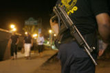 Police forces station themselves in low lit areas of Puerto Vallarta where criminal elements might...