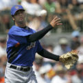 FLTD107 - New York Mets pitcher Nelson Figueroa throws out Houston Astros' Mark Loretta at first...