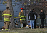 Aurora fire investigators at the scene of a 2 am fatal fire at 820 S. Ironton St., Friday morning,...