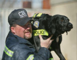 CBI Agent Jerry Means (cq) demonstrates how he carries Sadie, into and out of a fire scene, for...