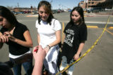 Neighborhood teens L-R  Twila Martinez, Corena Mascarenas and Selina Hernandez get their hands...