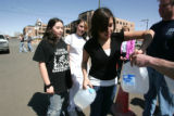 Neighborhood teens L-R  , Selina Hernandez, Corena Mascarenas and Twila Martinez, holding jugs,...