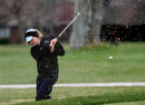 Kristen Kempton, Heritage High School, hits out of the sand-trap on the 8 hole,  Monday morning,...