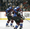 127 Colorado Avalanche #21 Peter Forsberg and Joe Sakic skate against the Calgary Flames in the...