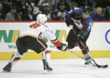 642 Colorado Avalanche #55 Cody Mcleod takes a shot with Calgary Flames #8 Anders Eriksson...