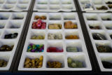 Beads are sorted in bins on tables tops at the store Beads Bead Beads. EDS visits the Ballpark...