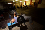 [Denver, CO - Shot on: 9/30/04] Andres Estrada, 30, lifts weights to keep in shape as he waits...