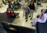 DM0867   Judy Webb, 54, center, swings the motion controlled sensor of a Nintendo Wii as patients...