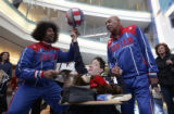 """Wildkat"" Edgerson, left, and ""Curly"" Neal, right, of the Harlem Globetrotters..."