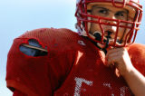 (DENVER, Co., SHOT 9/27/2004) Denver East High School OL/DL Mike Mora, a senior at the school,...