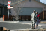 A National Guardsmen leaves a flyer with a homeowner in a neighborhood affected by a chlorine...