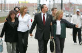 IICE agent Cory Voorhis, center, leaves the Alfred A. Arraj United States Courthouse with his wife...