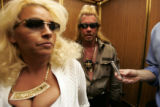 """ Dog the Bounty Hunter "", Chapman and his wife Beth Chapman ride the elevator at the..."