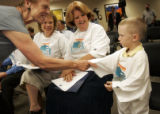 Charlotte Miller (cq), left, the DNC co-captain for Larimer County, shakes hands with Cole...