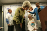 Kansas Gov. Kathleen Sebelius, a possible vice presidential candidate, leans down to talk with...