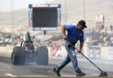 Frank Evancich cleans the track in the Super Comp qualifier at the Mile-High Nationals at...