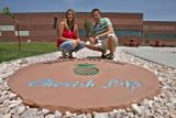 Lindsay Hayden (cq), left, and Cameron Durand (cq), by a large plaque that their senior class...