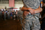 Jenny Hanson greets her husband, Trevor, at Buckley Air Force Base during a welcome home ceremony...