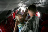 Jenny Kidd greets her fiancee, Trever Hanson, at Buckley Air Force Base in a cargo helicopter...