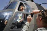 Trever Hanson takes a picture of his fiancee, Jenny Kidd, in a cargo helicopter at Buckley Air...