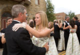 (Central City, Colorado, June 28, 2008) Sarah Ammons (center) waltzes with her father, Mark.  The...