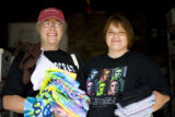Julie Rubsam, on left, Tina Eyre(cq) hold some of their stock that is for delivery across the ...