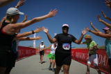 Michelle Simmons (cq) of Denver runs through the tunnel of love at the end of the Danskin...