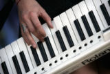 Victoria Asher of Cobra Starship plays keyboard during the 2008 Vans Warped Tour at Invesco Field...