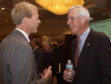 (DENVER, Colo., Sept. 30, 2004)  U.S. Senate candidate Pete Coors talks with Mike Smith after...