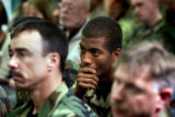 [Aurora, CO - Shot on: 9/30/04] Airman First Class David Sanders listens as  Iraqi citizens Abid...