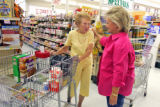 L to R: Long-time customer Wilma Dill chats with Vicki Edwards (cq) in Edwards Market of Fort...