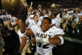 (COLORADO SPRINGS, COLO., SEPTEMBER 30, 2004)  Navy's #92-Pierre Moss celebrates Navy's 24-21...