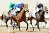 From left, Strawberry Sunday ridden by Orlando Martinez, Skysha ridden by Russell Vicchrilli and...