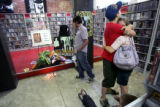 Brent Fabschutz, 20, and Raaden Perry, 21, console each other at Independent Records following...