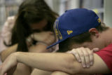 Brent Fabschutz (cq), 20, and Raaden Perry (cq), 21, mourn the death of Johnny Schou, 22, of the...